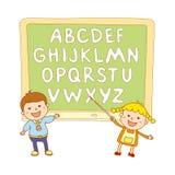 Lurar skolakonstpojken, abc, alfabetet, aducation, Arkivfoto