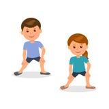 Lurar yoga Pojke- och flickaanseendet utför gymnastiska övningar Arkivfoto