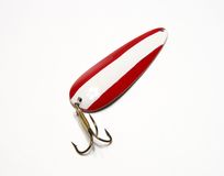 Lure. Red and white lure - daredevil spoon isolated on white background stock photo