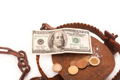 Lure. Banknotes and coins in the middle of the trap on a white background Royalty Free Stock Photography