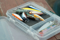 Lures. Plastic hardbaits (wobblers) in box Royalty Free Stock Images