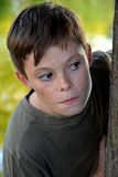 Lurking boy Stock Photography