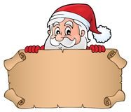 Lurking Santa Claus holding parchment 1. Eps10 vector illustration Royalty Free Stock Photos