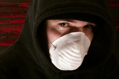Lurking in the shadows. A male lurking in the shadows wearing a mask Royalty Free Stock Photography