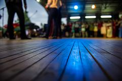Lurred silhouettes of people and dance floor stock image