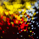 ?lurry festive lights in the shape of a heart. Background of blurry festive lights in the shape of a heart Stock Photography
