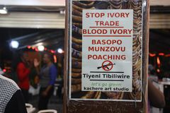 A poster in a shop calling for stopping illegal poaching and ivory trafficking royalty free stock photos