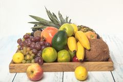 Luscious, gorgeously arranged fruit tray on the table. Healthy fruit background ; Studio photo of different fruits on white and  blue  vintage wooden table Royalty Free Stock Photography