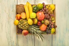 Luscious, gorgeously arranged fruit tray on the table. Healthy fruit background ; Studio photo of different fruits on white and  blue  vintage wooden table Royalty Free Stock Photo