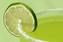 Luscious Lime. A closeup of a juicy lime on the salty rim of a margarita glass stock images