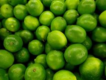 Luscious Limes. Are bright green and have a sour taste. This citrus fruit is a good source of Vitamin C royalty free stock photos