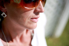 Luscious Lips. A woman wearing sunglasses with luscious lips royalty free stock image