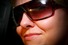 Luscious Lips. A woman wearing sunglasses with luscious glossy lips royalty free stock photos