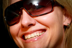 Luscious Lips. A woman wearing sunglasses with luscious glossy lips stock photography