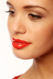 Luscious Red Lips. Closeup of a beautiful woman with luscious full glossy red lips royalty free stock image