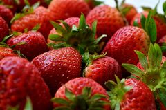 Luscious Strawberry Background. This photo captures the strawberries as fresh new strawberries royalty free stock images