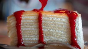 Luscious Strawberry Sauce Crepe Cake stock photo
