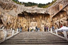 Lusena Boedha in Longmen Grotten China Stock Afbeelding