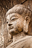 Lusena Buddha. Nishyandabody Buddha [lushena or Lusena]  in Longmen Grottoes, luoyang china. It was  Built in 675 AD Tang Dynasty, It is said that it was after Royalty Free Stock Photography
