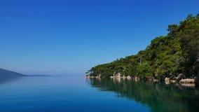Lush Akyaka Coastline 01. An idyllic view of lush Akyaka coastline Gulf of Gokova, Mugla, Turkey early in the morning. Calm sea mirrors the dense Mediterranean stock video