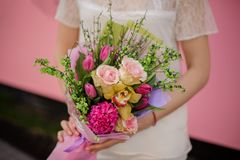 Lush bouquet of roses, iris and tulips royalty free stock photo