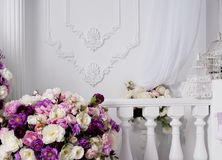 Lush bouquet of roses near decorative balcony Stock Image