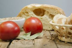 Lush bread with tomato on a wooden background stock photos