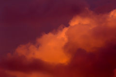Lush clouds in fiery red tones Stock Images
