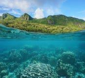 Lush coast and coral reef split French Polynesia Royalty Free Stock Photos