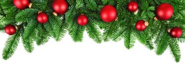 Lush fir twigs and red baubles on white Stock Photos