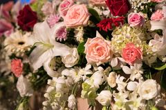 Variety of flowers decorated in wedding reception. Lush floral arrangement on wedding reception. Variety of flowers decoration Stock Image