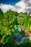Lush garden. Elevated view of a lush green garden with pond royalty free stock images