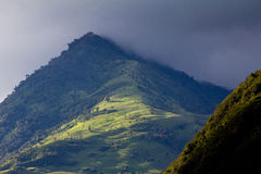 Lush green Andean landscape and rain clouds. Lush green Andean mountain landscape and rain clouds Royalty Free Stock Photos