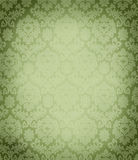 Lush green damask pattern wallpaper texture. Elegant background pattern in repeat with a vintage faded texture copy ready perfect for christmas cards or wrapping Stock Images