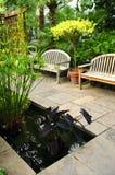 Lush green garden Stock Photos