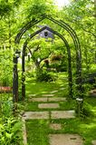 Lush green garden. With wrought iron arbor Stock Photography