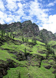 Lush green  himalayan mountain range and valley ,. Lush green  himalayan  cliff  near manali, india Royalty Free Stock Images