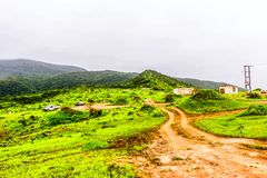Lush green landscape, trees and foggy mountains in Ayn Khor tourist resort, Salalah, Oman. Summer In Salalah Oman, Lush green landscape, trees and foggy royalty free stock images