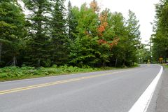 Twisty road thru Northern Michigan. Copper Harbor royalty free stock images
