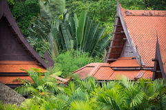 Lush green vegetation. And traditional constructions in Thailand royalty free stock image
