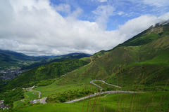 Lush greenery  landscape panorama of Mount Yufu, road lines and Stock Photo