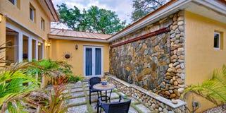 Lush landscaped patio Stock Image