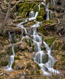 Lush moss covered waterfall in the Colorado Rocky Mountains. Water cascades down a mossy waterfall on the Hanging Take Trail, located in Glenwood Canyon, located royalty free stock images