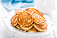 Lush pancakes. On a plate Royalty Free Stock Photography