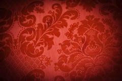 Lush Red Sofa. A lush red sofa pattern of swirls Royalty Free Stock Photography