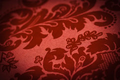 Lush Red Sofa. A lush red sofa pattern of swirls Stock Images