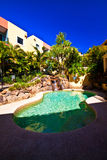 Lush Resort Pool. Another lush resort style swimming pool Stock Photos