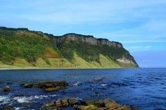 Lush Sea Cliffs at Bearreraig Bay. Towering lush sea cliffs at Bearreraig Bay in Scotland Stock Images