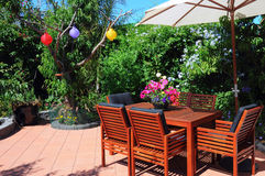 Lush summer courtyard garden. Close up on entertaining area. Stock Photo