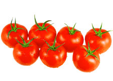 Lush tomatoes . Isolated. Over white Royalty Free Stock Images
